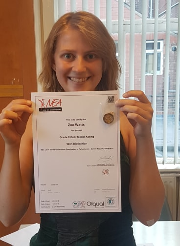 Image of Zoe Watts holding certification.