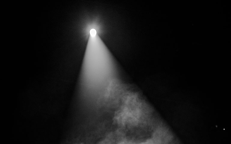 Image of a spotlight in a concert